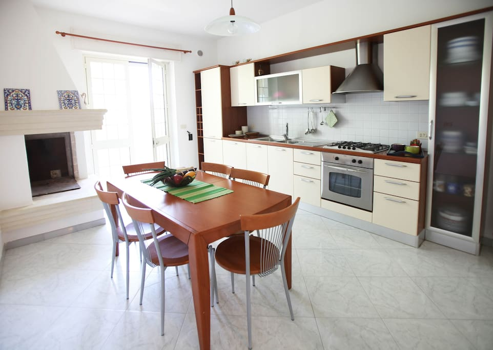 Fully furnished kitchen, in annex a small storage and laundry space.