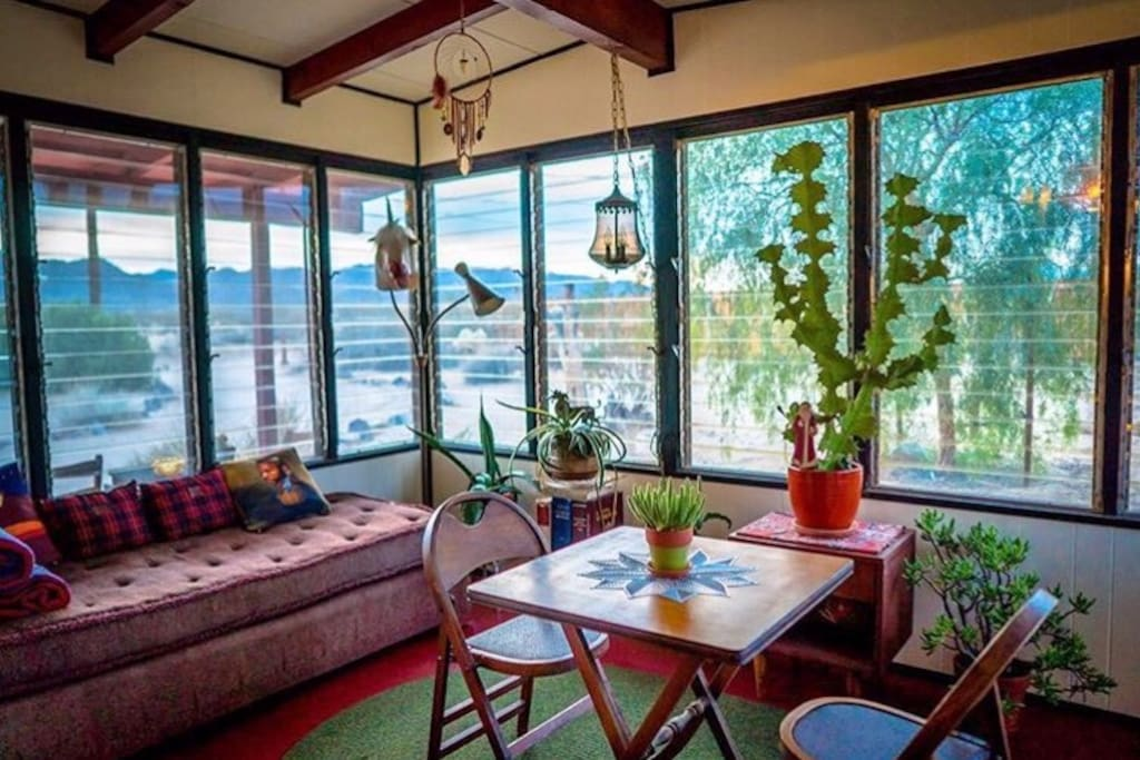 The beautiful sunroom w spectacular views of the desert.