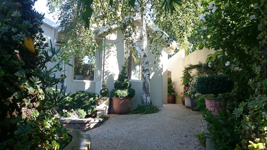 Pathway to self contained private accommodation - evening dappled light.. One step into property front and back door..