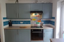 Kitchen with induction hob and twin zone oven