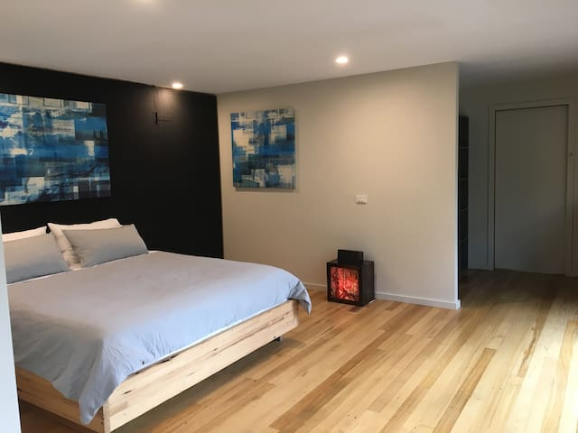 spacious master bedroom with en-suite and walk in robe