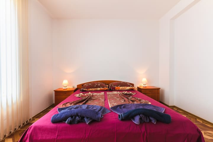 room with a double bed on the 1st floor, with a balcony, from where the pool is clearly visible