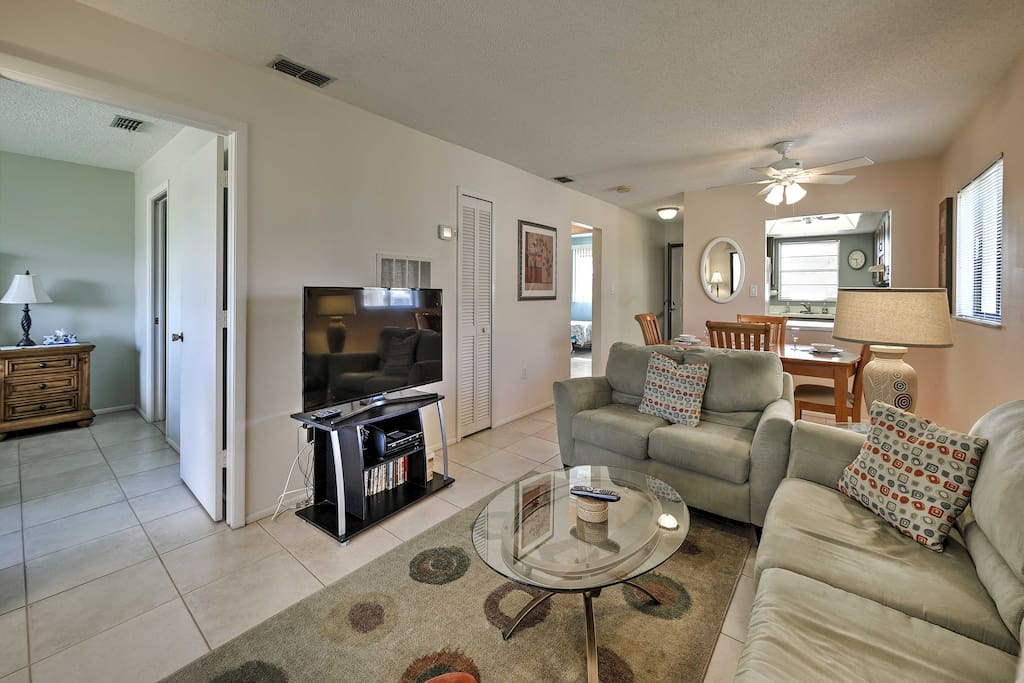 The spacious interior of this condo features comfortable furnishings and all your essential comforts to make you feel right at home.