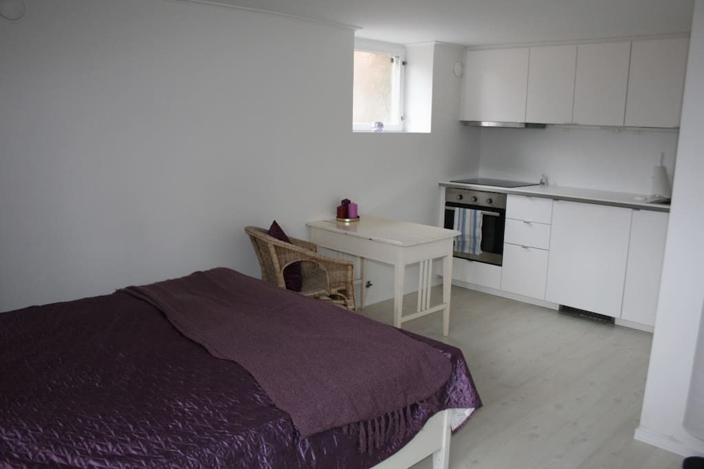 Bed, table and the kitchen