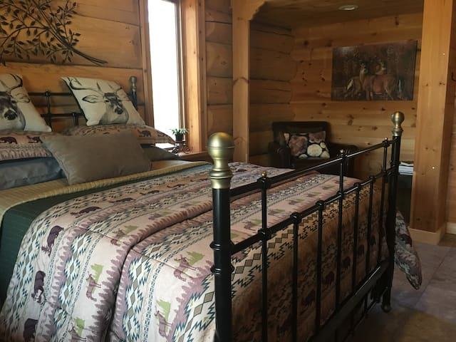 Country LOG CHALET room and a private bathroom.