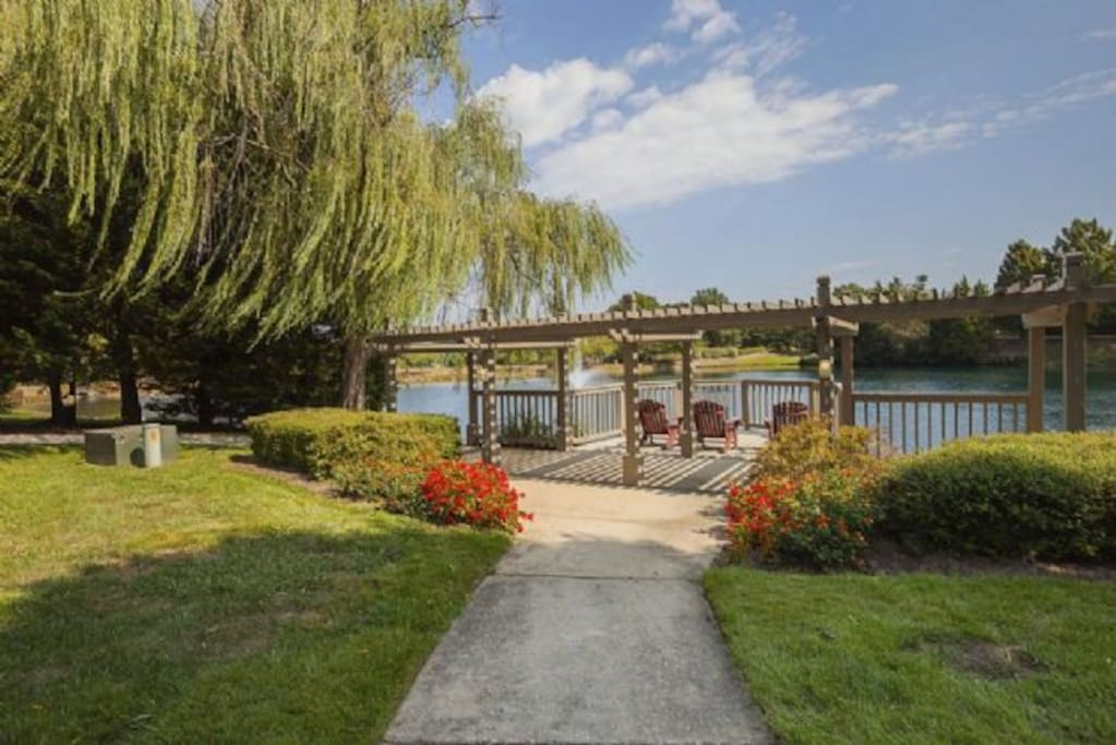 Pergola seating area with a great pond view
