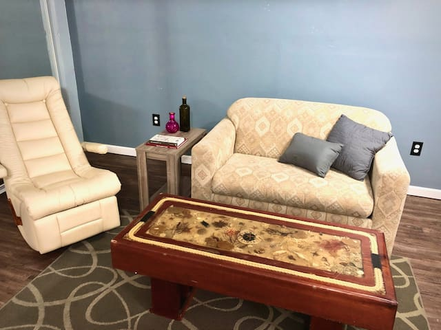 Loveseat with a pull out single bed.