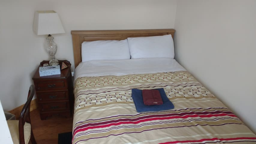 Cozy double bedroom with brand new double bed