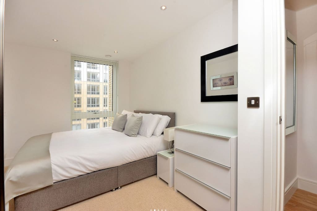 Bright and airy double bedroom with fitted cupboards and wardrobes.