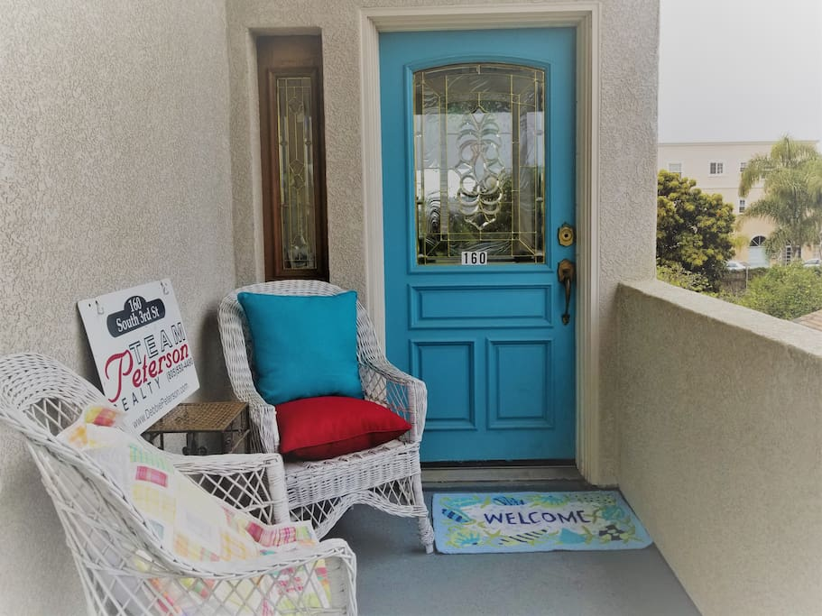Relax on the front porch while you wait for friends and family.