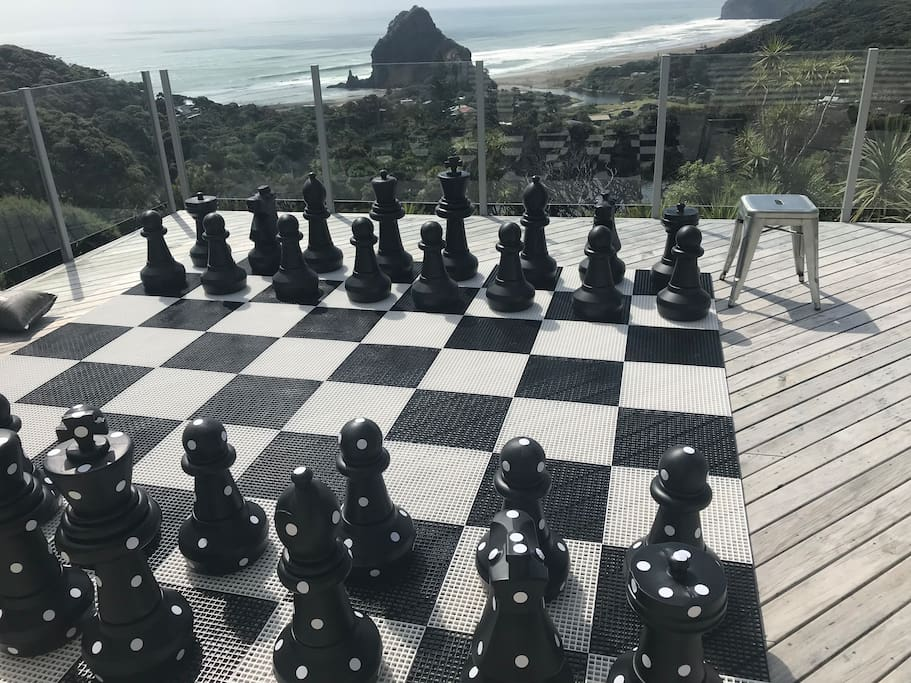 Large decks and stunning Piha Beach views. Outdoor chess set.