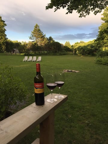 Enjoy a glass of county wine on the back deck over looking the natural PEC beauty