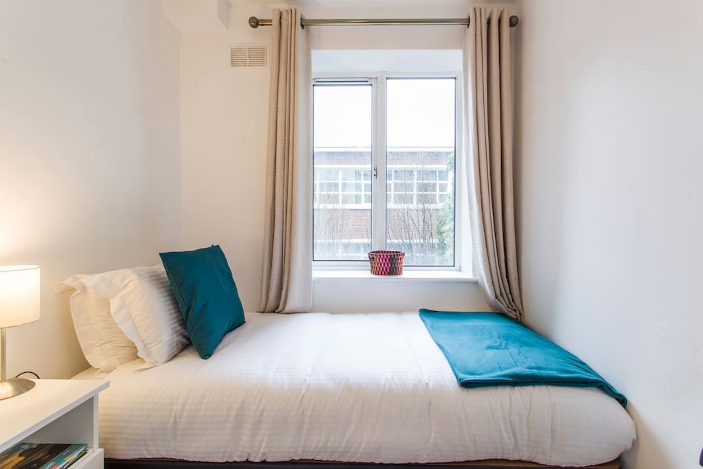 Single room with lovely bed and hotel quality linens