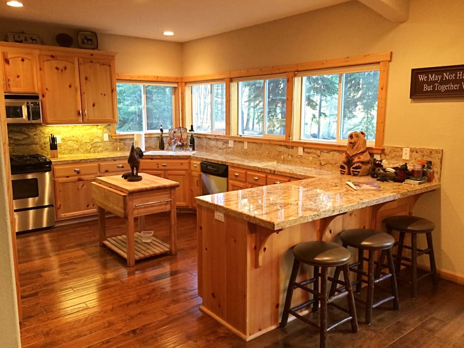 Kitchen with gas stove, large side by side refrigerator, walk in pantry