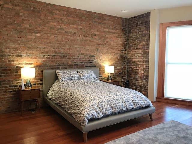 Queen sized bed in front bedroom.