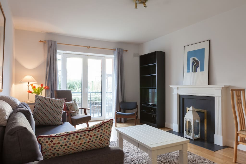 Bright sitting room with sofa bed,tv,wi fi internet, wonderful garden view with access to patio.