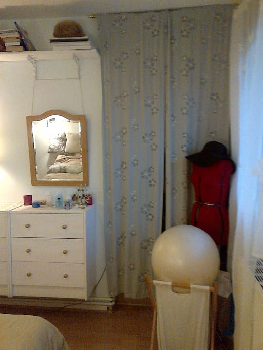 Behind the curtains - wardrobe with hangers and drawers.Feel free to use the exercise ball for morning stretch.
