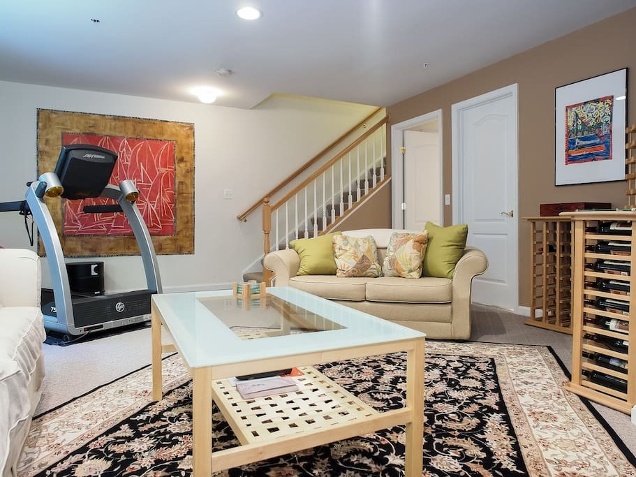 Rental includes your own Private Living Room - view to stairs to the main level