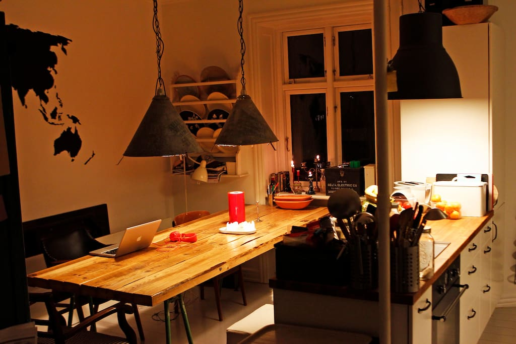 """Our favorite room in our newly renovated apartment. This is pretty much the only room we use except when we are sleeping. There's a living room too…but it's hard to get out of our """"Kitchen"""" and our handmade wooden table!"""