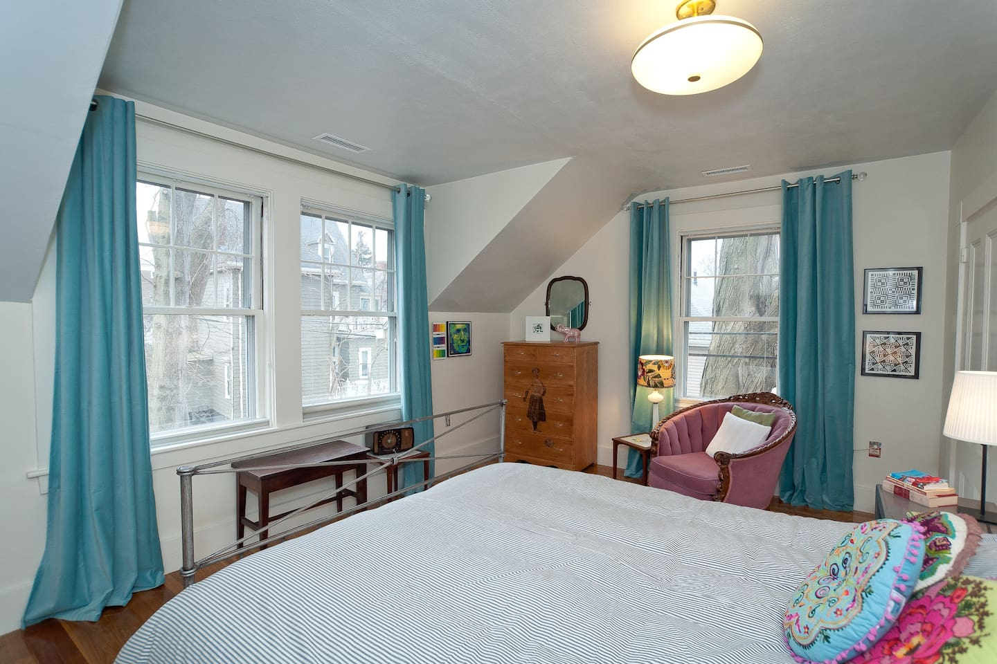 This room is the sunniest! It has southern and eastern facing windows.  You can see crazy squirrels on the large tree.