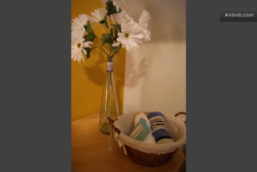Washcloth, samples of soap, shampoo and cream.