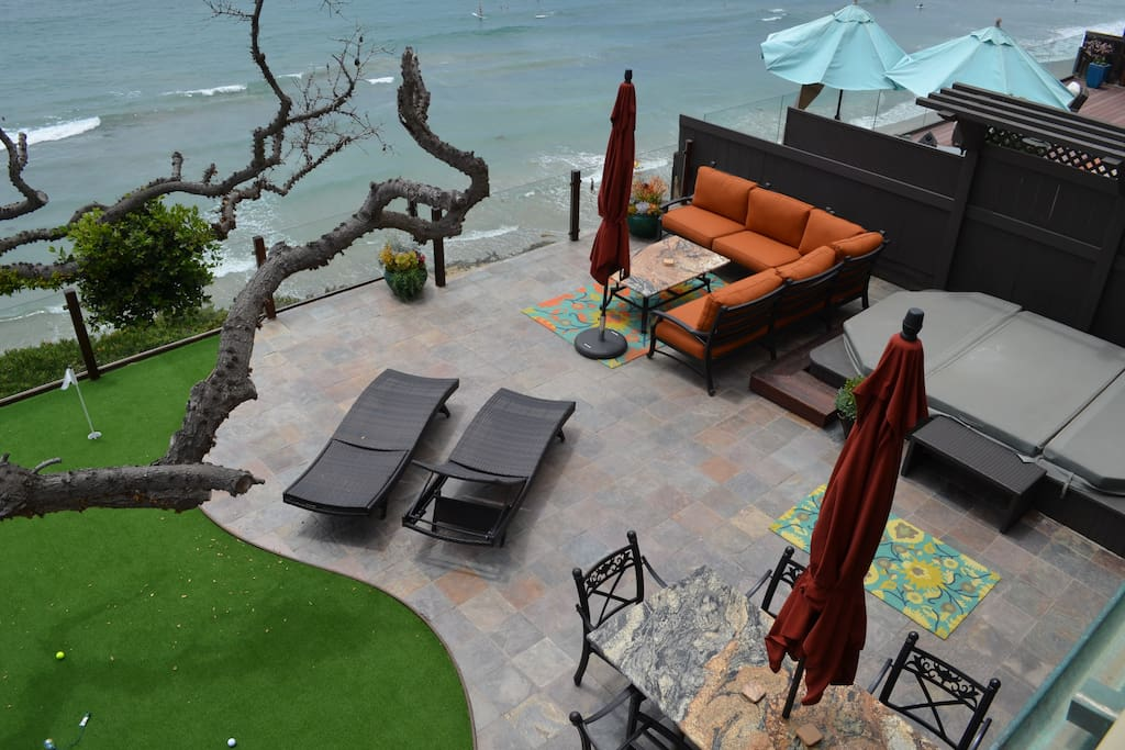 Outdoor area includes a granite grill/bar, putting green, huge jacuzzi/pool, granite dining table and living room