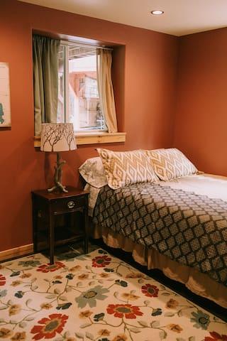 Burgundy bedroom with queen bed