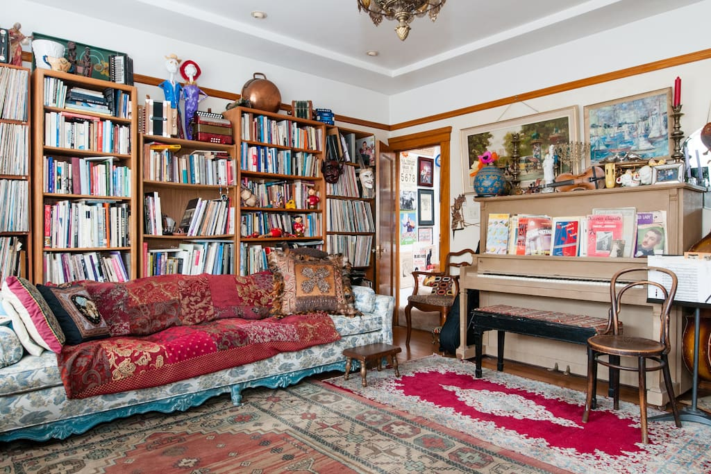Another view of beautiful large living room with piano where you are free to make yourself at home.