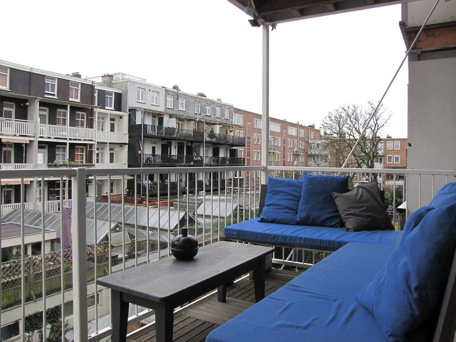 The balcony. With a nice big cornercouch. In the summer a wind free sunny place. But in the winter a good place for red wine and a sigaret!