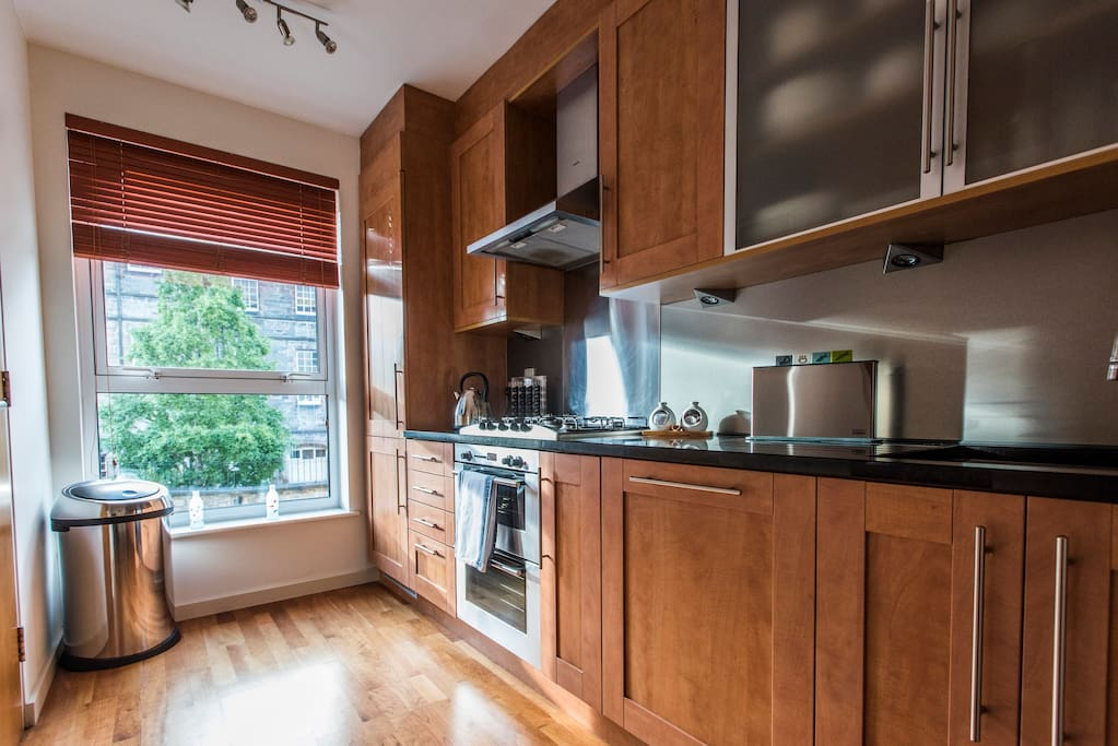 Modern fully equipped fitted kitchen with integrated appliances including fridge/freezer, dishwasher, oven, gas hob and canopy.  There is also a microwave, washer/dryer and Nespresso coffee maker.