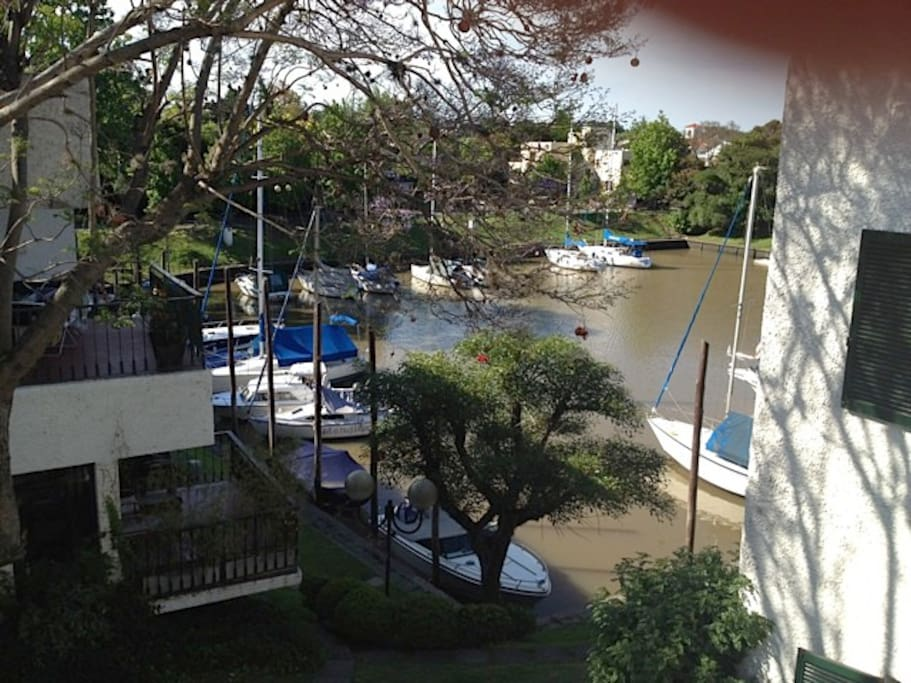 View from the stairs (entrance door of the flat) to the lagoon, where the boats are. It really feels like vacations :)