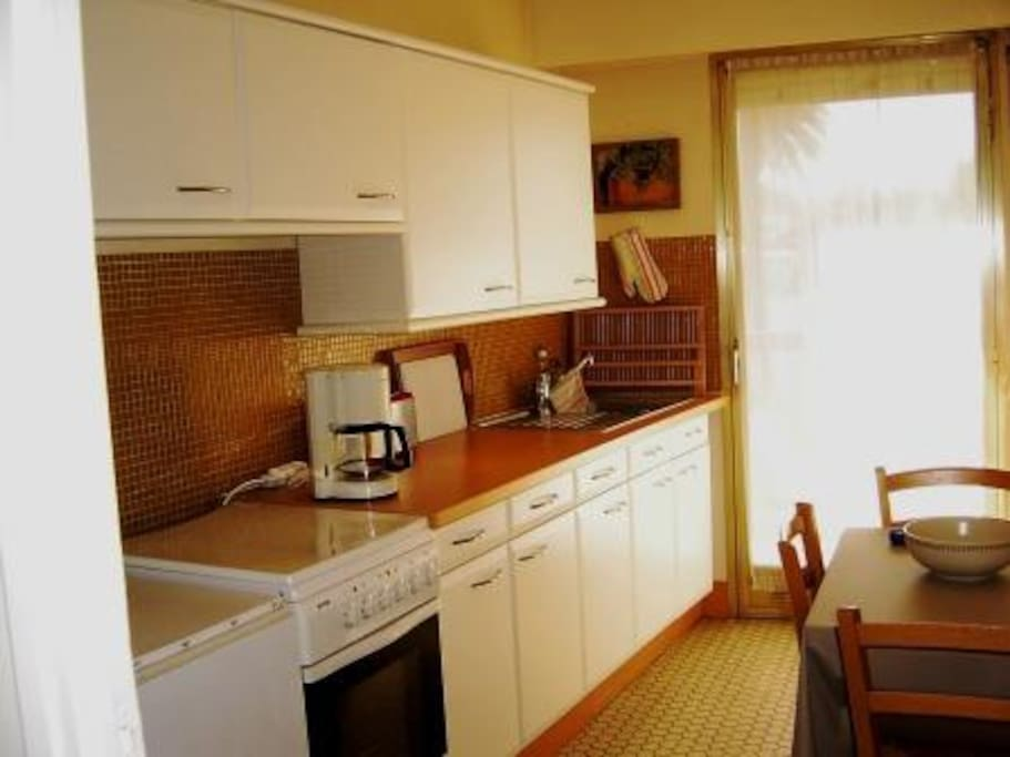 Kitchen with fridge and Washing Machine