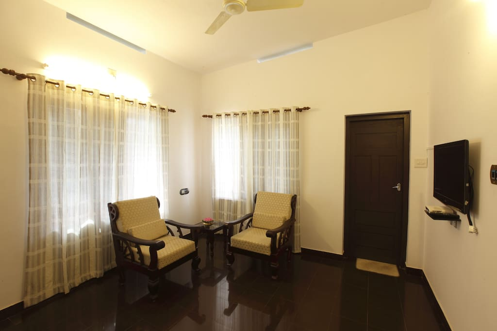 Living room of the only suite available in the property. Airconditioned with en suite bathroom