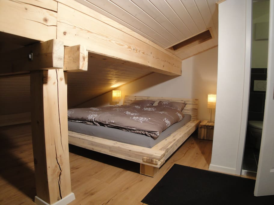 Part of the bedroom. The mattress is ergonomic and the entire room is newly-renovated to the highest standards.