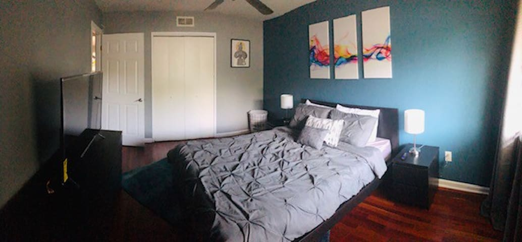 """Master Bedroom with 50"""" smart TV, Queen Bed and closet"""