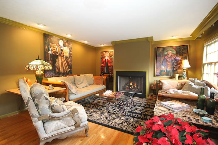 Spacious living room with 2 Ralph Lauren day bed sofas for extra guests and a gas fireplace. Lot of art work, too.