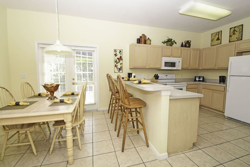 Kitchen with breakfast bar seating as well as breakfast table
