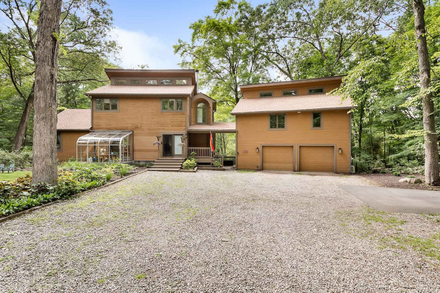 Enjoy a peaceful retreat in the woods of the Hudson Valley, moments away from the Hudson River, nature trails and restaurants. The apartment comprises the entire top floor of the building on the right. You have a private entrance.