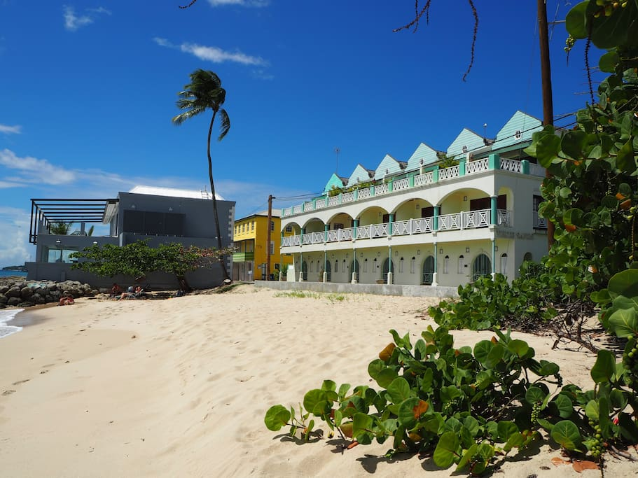 White Sands condo as seen from the beach. Hugo's first class restaurant is the grey building at the left