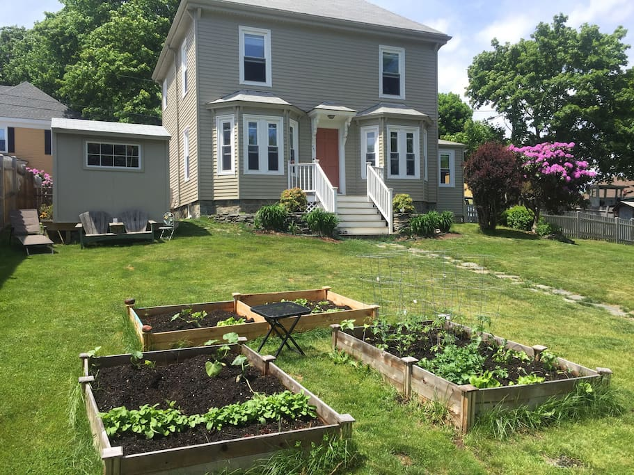Our house has a fenced in yard with outdoor seating,  plenty of space for grownups and children to play.