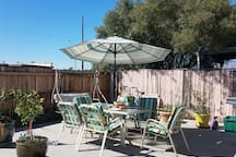 Back yard patio with swing!