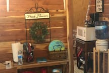 At the Choctaw Treehouse there is a full sized refrigerator, a hot plate, griddle, a saucepan, two skillets, a microwave, a coffee pot, as well as mixing bowels, cups, plates, & cooking/mixing utensils.