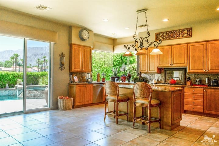 Kitchen overlooking pool and living room