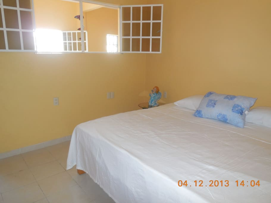 Main bedroom with double bed and toilet