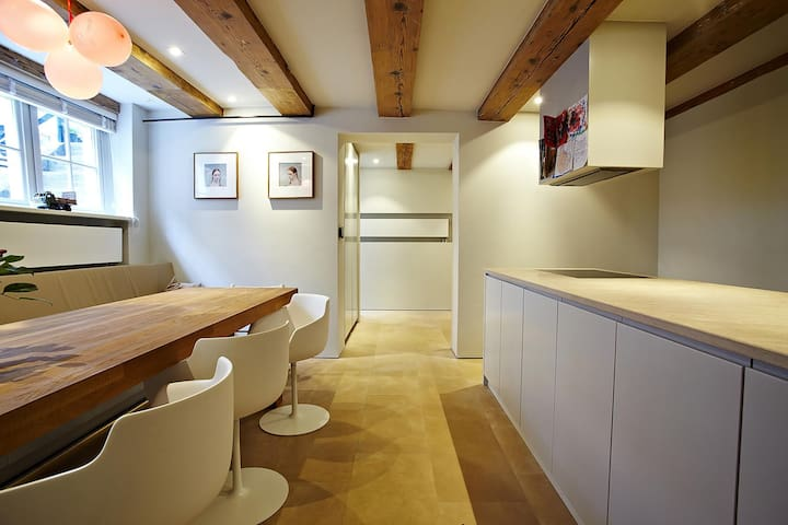After the entrance you find the open modern kitchen