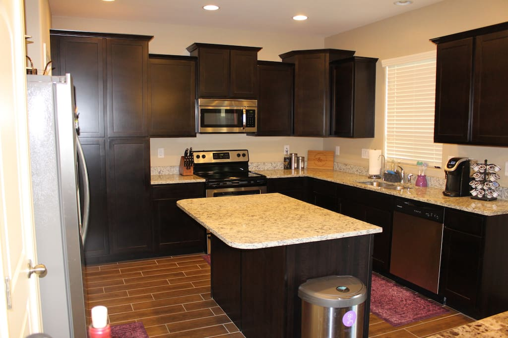 You will enjoy making meals in this kitchen with it's brand new stainless steal appliances. For your convenience you will also find pots and pans, cooking utensils, silverware, glassware, plates and bowls, dining table, and a coffee maker.