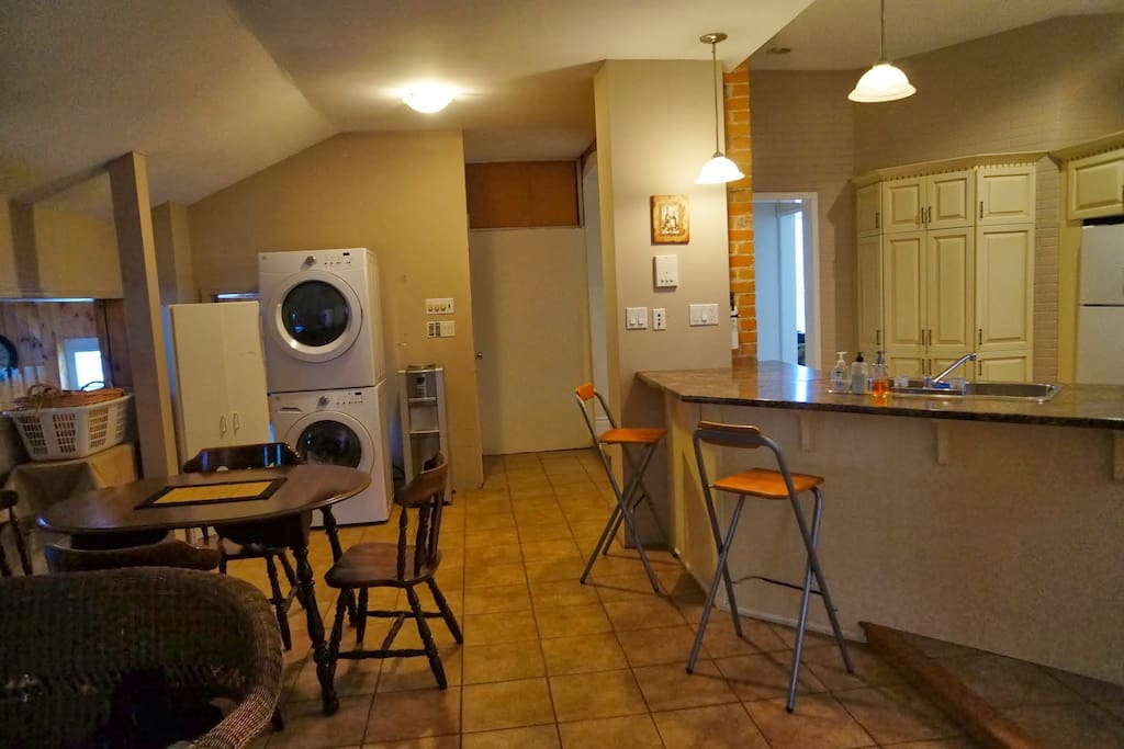 Large eat-in kitchen looks out onto pool and has stackable washer and dryer