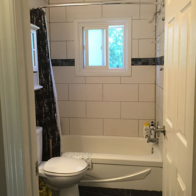 Custom renovated tiled upstairs bathroom with marble floors.