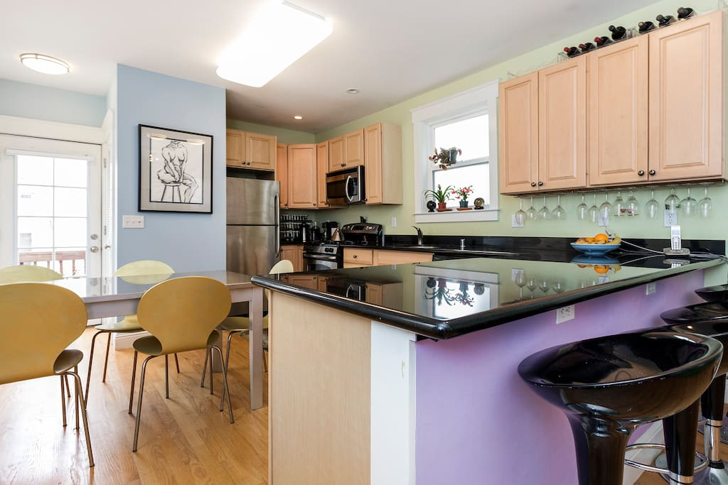 Bright gourmet eat-in kitchen with counter seating.
