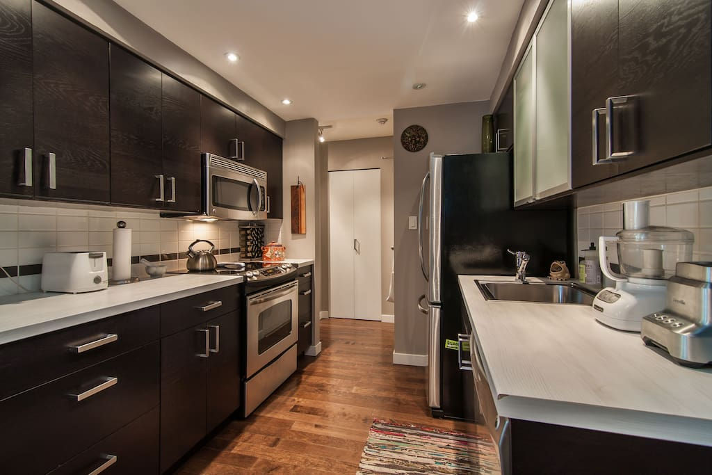 Very wide galley style kitchen with all new appliances and fully equipped.